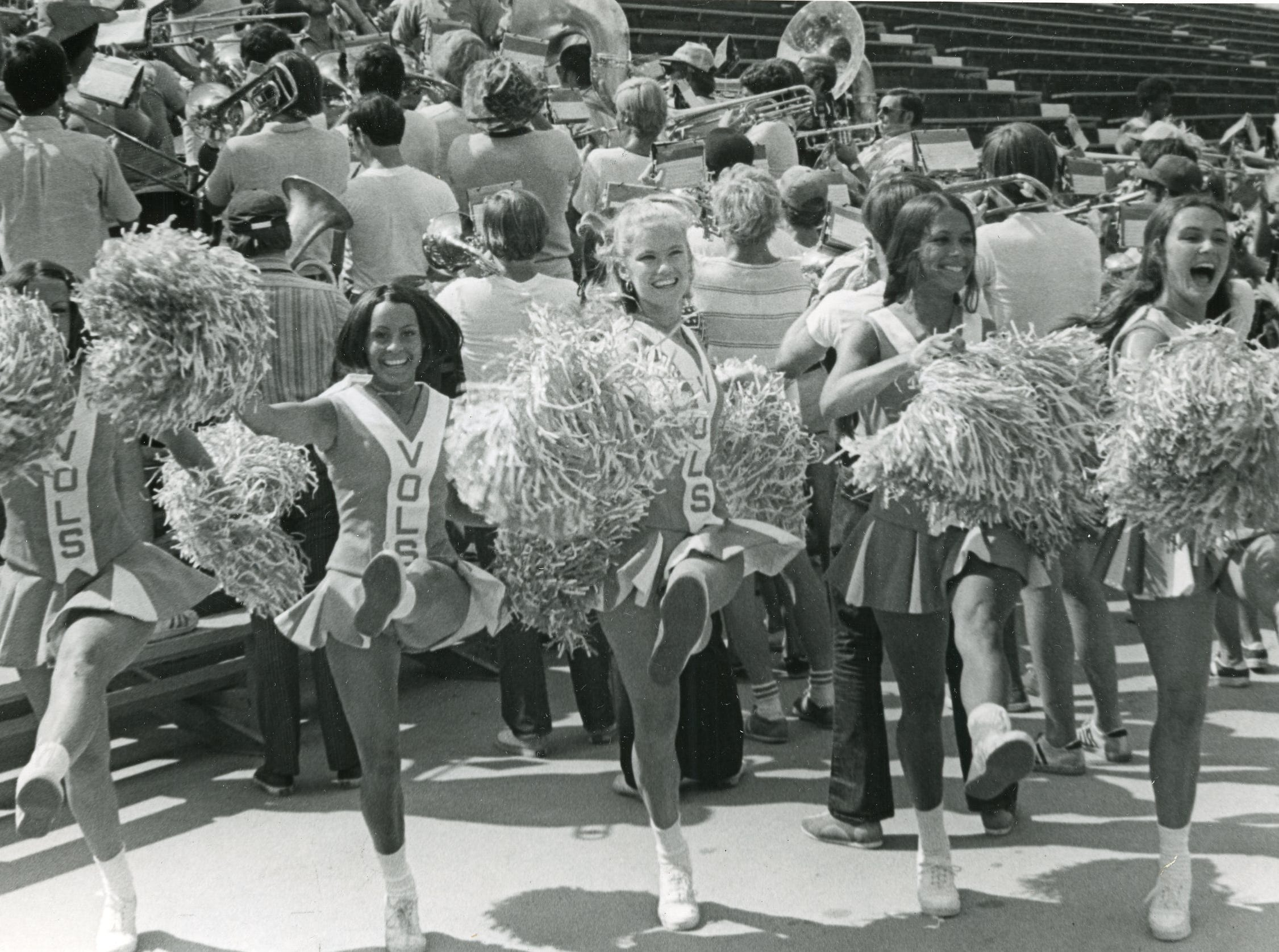 Members of the 1972 UT cheer squad perform with the band at a September game.