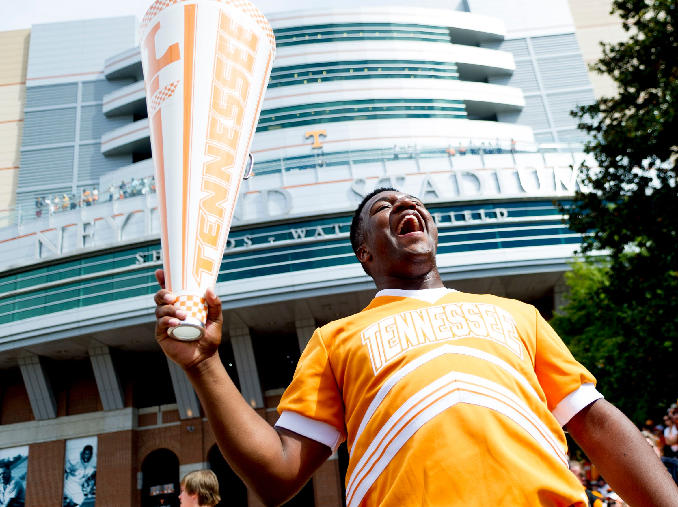 A UT cheerleader pumps up the crowd during the Vol Walk during the Tennessee Volunteers vs. Georgia Bulldogs game at Neyland Stadium in Knoxville, Tennessee on Saturday, September 30, 2017.