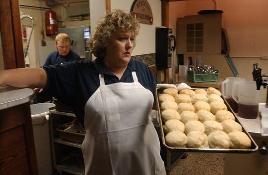 File photo: Rankin Restaurant is a longtime Central Avenue landmark known for its home cooking. Sheila McGinnis delivers a tray of fresh biscuits to serve to the lunch crowd.