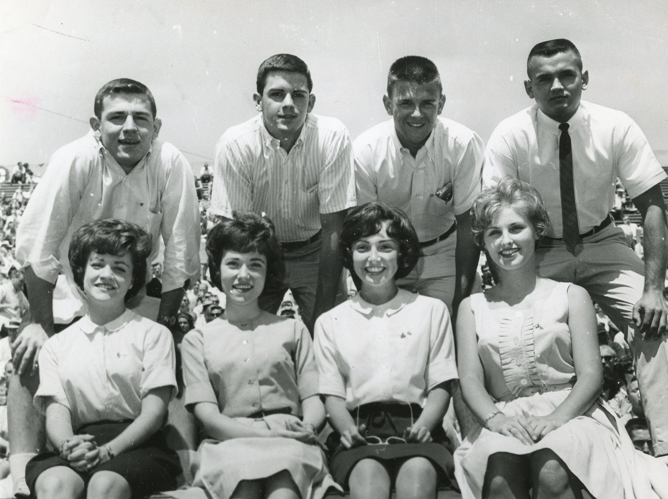 Members of the 1963 UT cheer team included (front) Linda May, Sandra Duncan, Pat Handly, Wallene Threadgill; (back) Pete Thompson, Charles Baker, Jim Bankston and Bob McConkey. Not pictured were Bob Martin and Janet Stanford.