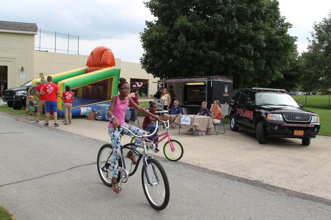 Children and families attend Lafayette's National Night Out event Tuesday, August 2, 2016, outside Loeb Stadium at Columbian Park.