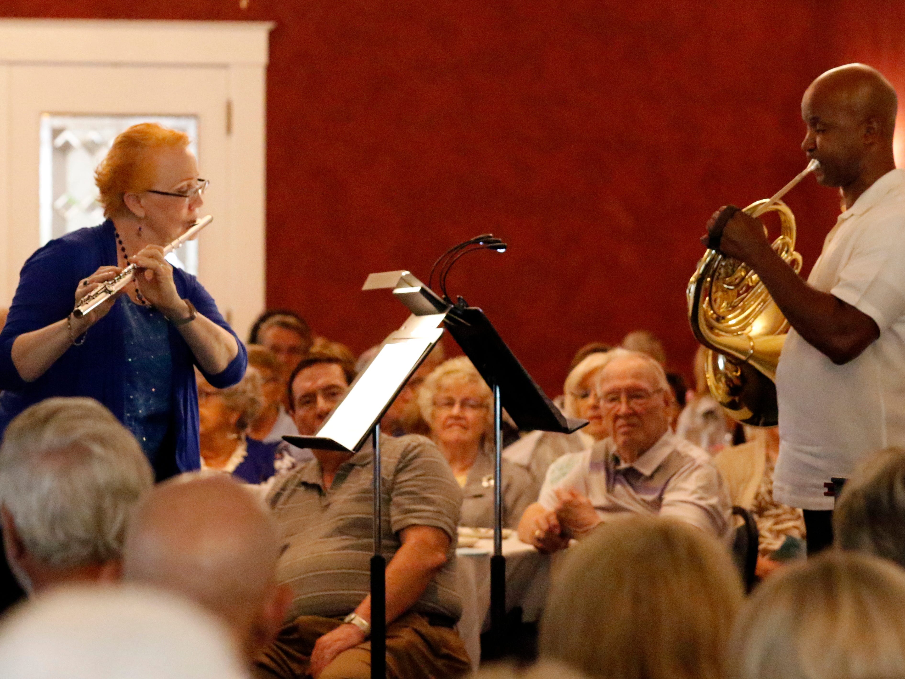 Margaret Swinchoski, left, and Joseph Lovinsky perform Friday afternoon, July 27, 2018, during a Lancaster Festival Cafe Concert at the Lancaster Country Club in Hocking Township. The concert featured principal members from different sections of the Lancaster Festival Orchestra.