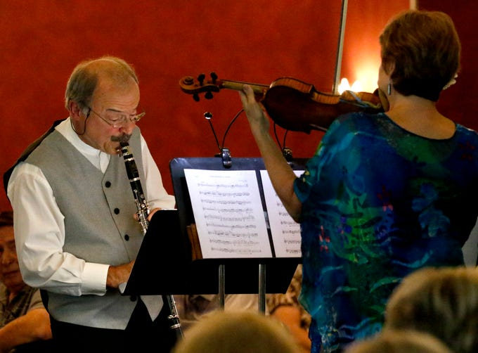 Les Nicholas, left, and Stephanie Sant'Ambrogio, right, perform with Judith Lynn Stillman, not pictured, Friday afternoon, July 27, 2018, during a Lancaster Festival Cafe Concert at the Lancaster Country Club in Hocking Township. The concert featured principal members from different sections of the Lancaster Festival Orchestra.