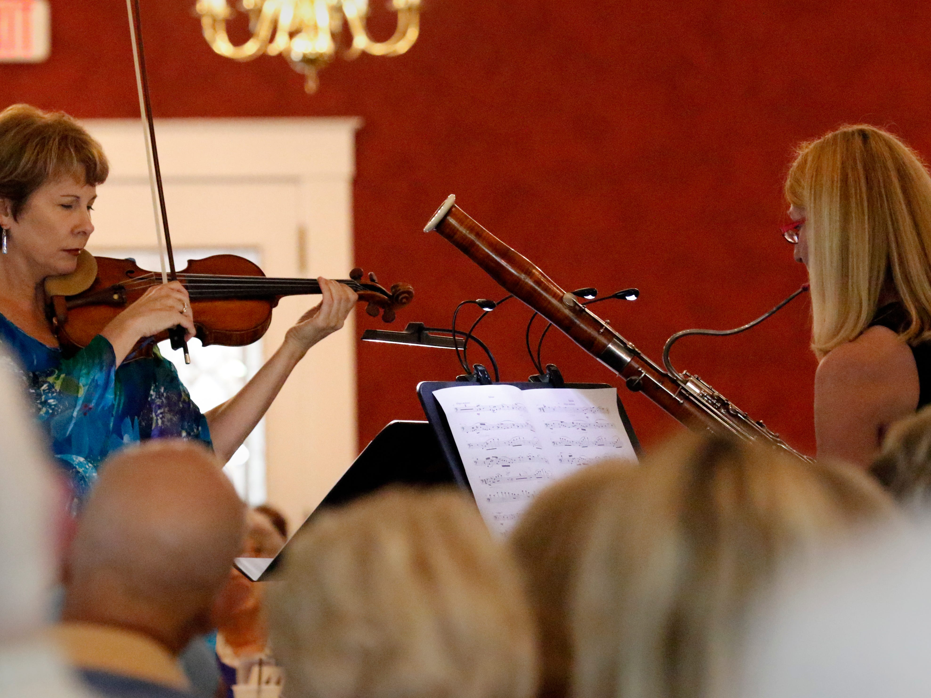 Stephanie Sant'Ambrogio, left, and Linda Fisher perform Friday afternoon, July 27, 2018, during a Lancaster Festival Cafe Concert at the Lancaster Country Club in Hocking Township. The concert featured principal members from different sections of the Lancaster Festival Orchestra.