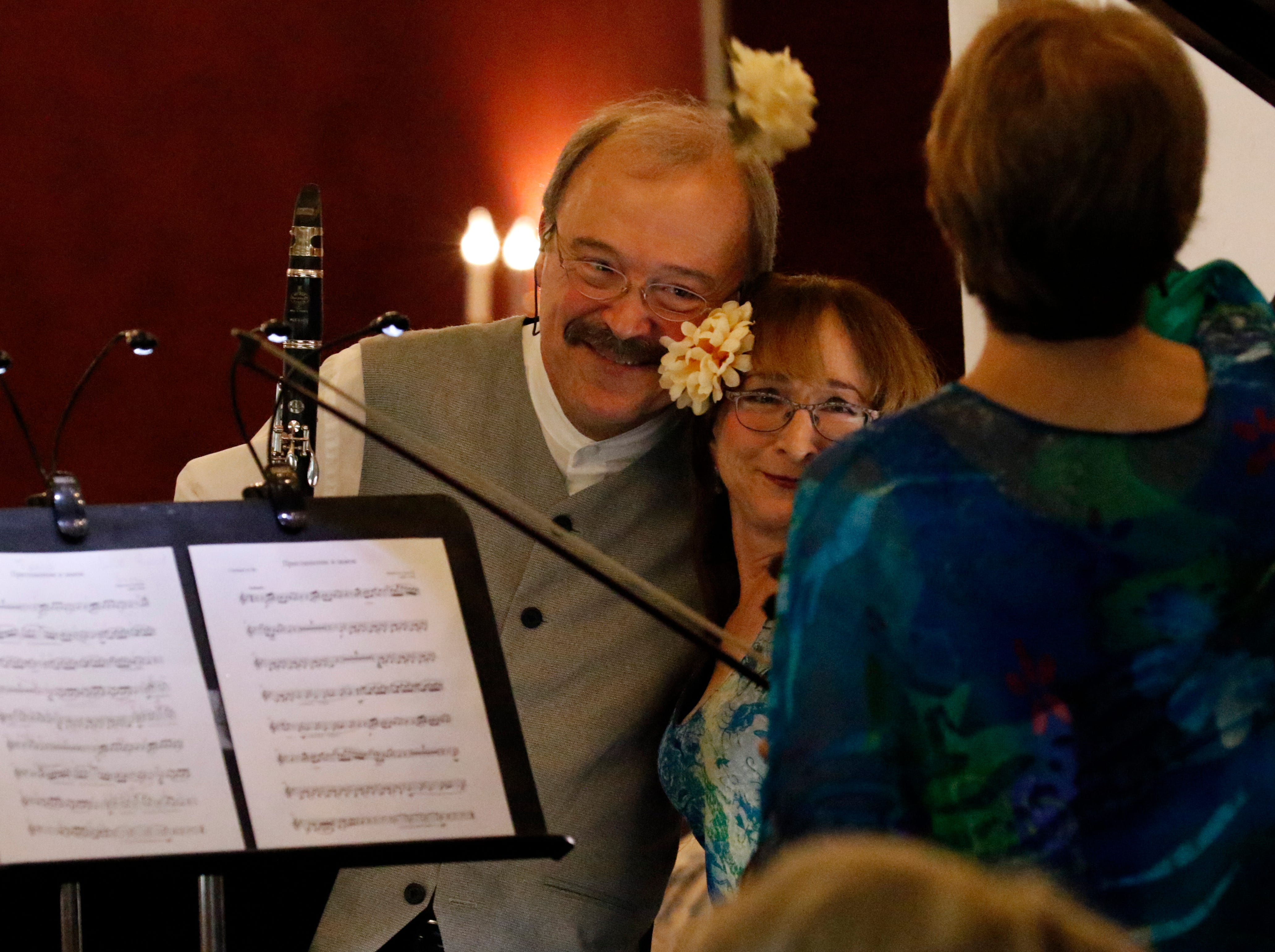 Les Nicholas, left, hugs Judith Lynn Stillman after performing with Stephanie Sant'Ambrogio Friday afternoon, July 27, 2018, during a Lancaster Festival Cafe Concert at the Lancaster Country Club in Hocking Township. The concert featured principal members from different sections of the Lancaster Festival Orchestra.