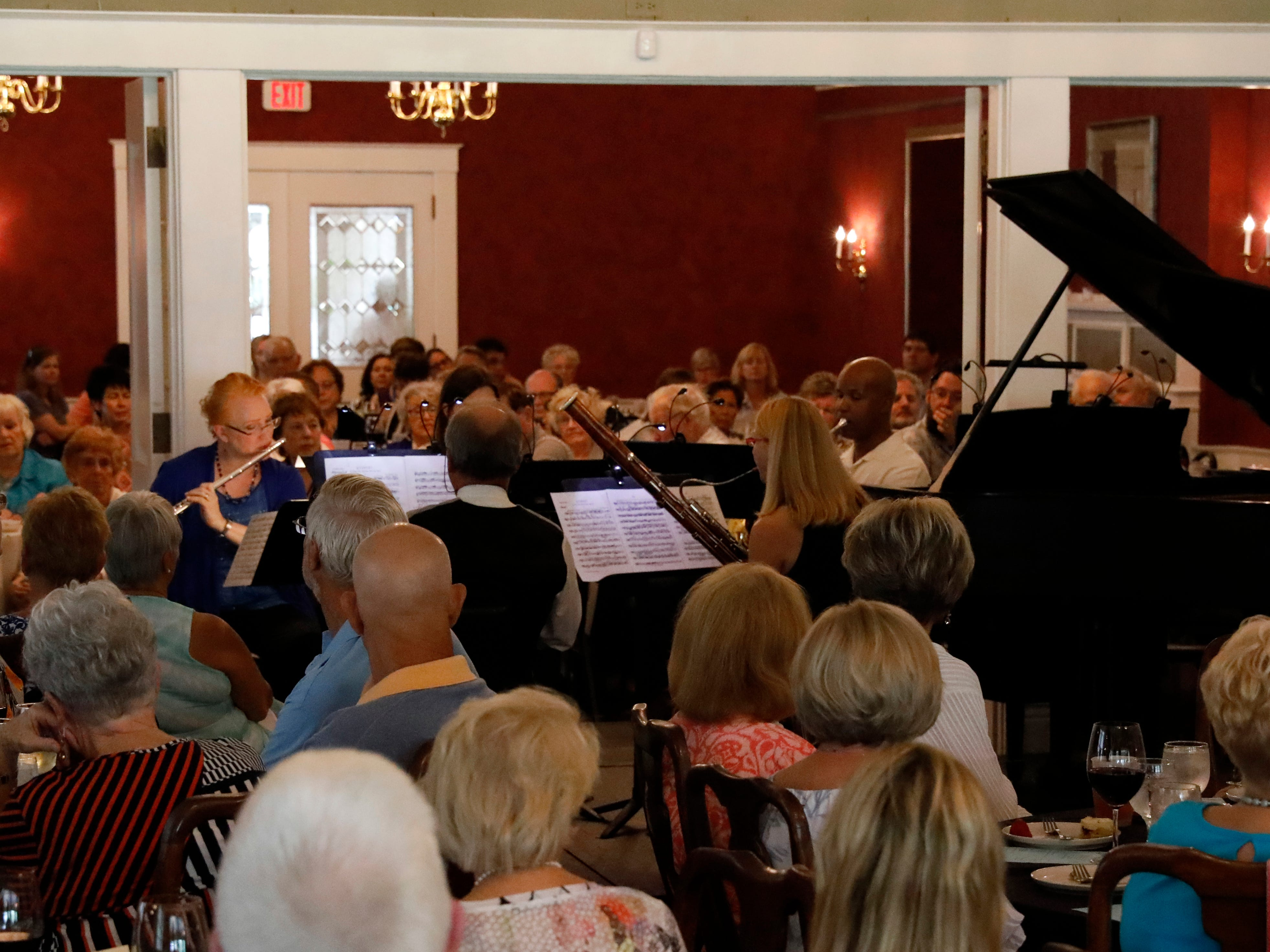 Members of the Lancaster Festival Orchestra woodwind quintet perform Friday afternoon, July 27, 2018, during a Lancaster Festival Cafe Concert at the Lancaster Country Club in Hocking Township. The concert featured principal members from different sections of the Lancaster Festival Orchestra.
