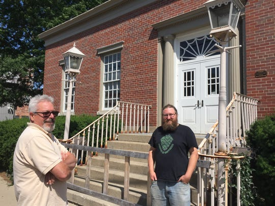 Craig Gantner (left) and Aaron Guild discuss their plan to open Old Post Brewing Company in a former post office at 121 S. Walnut Street in downtown Howell on Thursday, July 26, 2018.