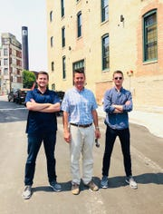 Developers Peter Moede Sr. (middle) and sons Joe and Peter Jr. are converting former tannery buildings into River Place Lofts apartments.