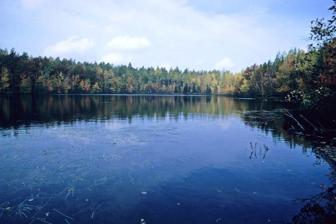 The natural beauty of Wisconsin is reflected in many classic books about the state. This is a view of Chequamegon  Lake in Chequamegon National Forest.