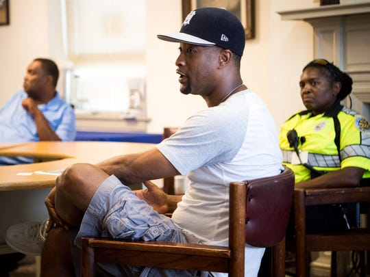 Michael Jordan, J. Henry Hale Resident Association president, speaks with Metro Nashville Deputy Chief of Police Brian Johnson (not pictured) during a community meeting at Bethlehem Centers about Thursday's police shooting in Nashville, Tenn., Friday, July 27, 2018.