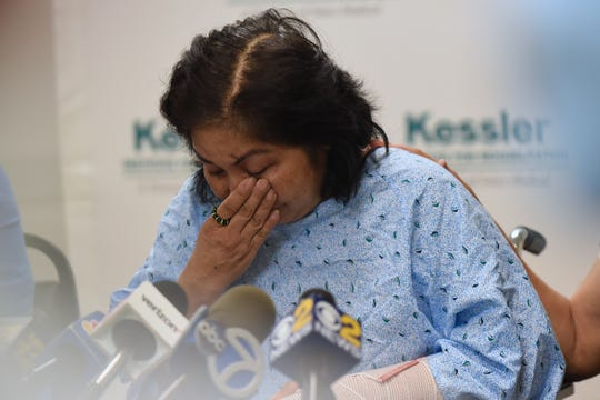 Mary Rose Ballocanag, the mother of the Trinidad family, is recovering form the car crash at Kessler in Saddle Brook, where a press conference is held on Friday July 27, 2018. Ballocanag holds back tears during the press conference.