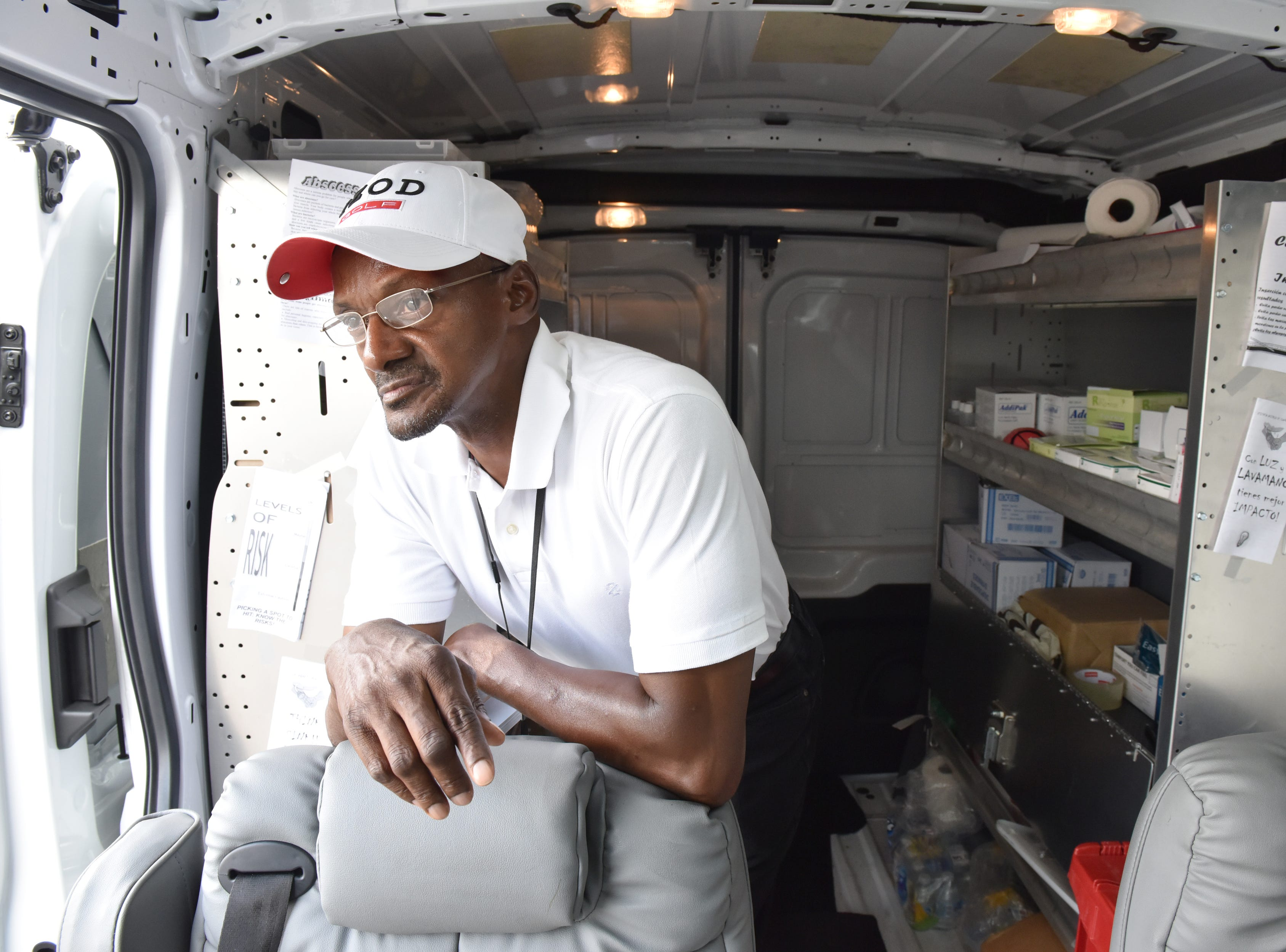 Ralph Henderson, a harm reduction specialist, waits by the van for clients to exchange syringes. A van parked in the Walgreen's parking lot provides clean needles in exchange for dirty ones twice a week in Paterson on Friday July 27, 2018. For every used syringe brought in, the harm reduction specialists with Hyacinth Foundation provides a new sterile syringe. The van is stocked with syringes of different sizes, alcohol wipes, constriction bands, cooking cups, water, strips to test for fentanyl, and other products to safely inject heroin.