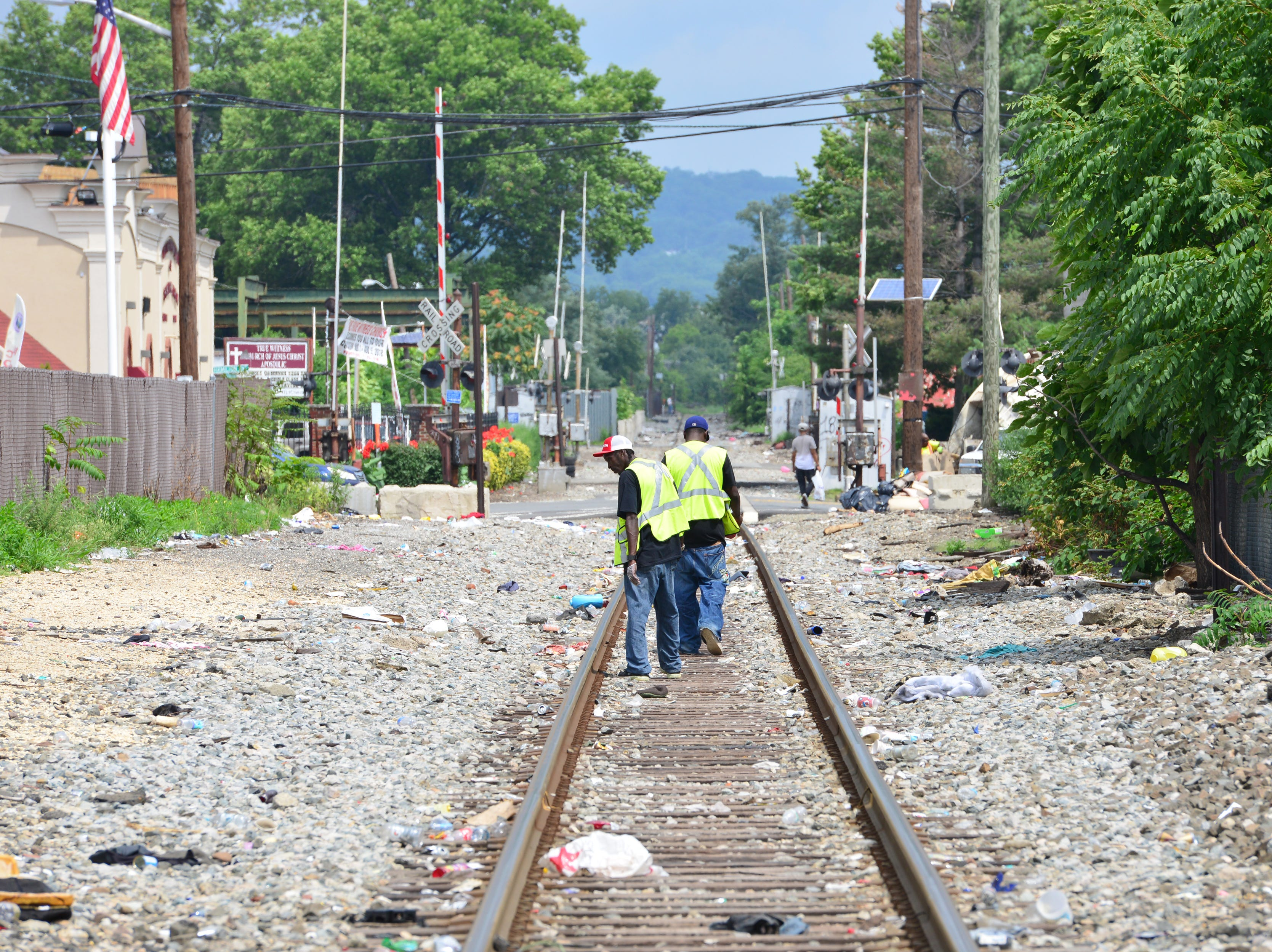 Outreach Workers of Hyacinth Foundation, walk along the railroad tracks in Paterson collecting syringes found on the ground. A van parked in the Walgreen's parking lot provides clean needles in exchange for dirty ones twice a week in Paterson on Friday July 27, 2018. For every used syringe brought in, the harm reduction specialists with Hyacinth Foundation provides a new sterile syringe. The van is stocked with syringes of different sizes, alcohol wipes, constriction bands, cooking cups, water, strips to test for fentanyl, and other products to safely inject heroin.