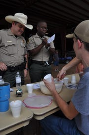 "Eddy County Sheriff's Deputies judge the ""Ice"" portion of the Fire and Ice competition at the Eddy County Fair July 27."