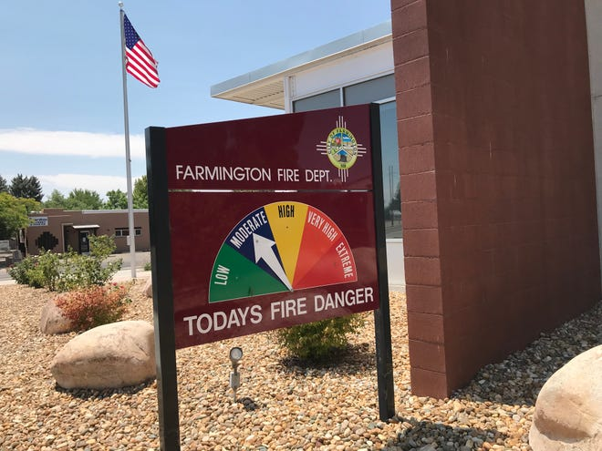 A sign displays the fire danger Friday at the Farmington Fire Department.