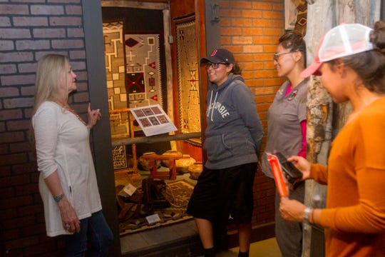Linda Winter, left, talks with visitors Carmaletha Bitsoi, left, Kyrie Eleison and Roxanne Benally Thursday at the Toadlena Trading Post and Weaving Museum in Toadlena.