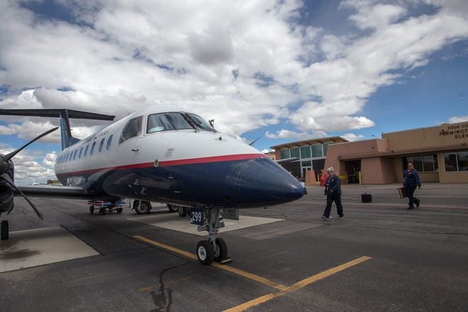 A Great Lakes Aviation plane sits on the tarmac shortly after landing on May 28, 2017, at the Four Corners Regional Airport in Farmington.