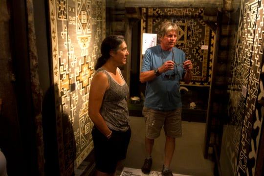 Regan and Jim Haines of Bellingham, Wash., examine rugs in the weaving museum Thursday at the Toadlena Trading Post and Weaving Museum in Toadlena.