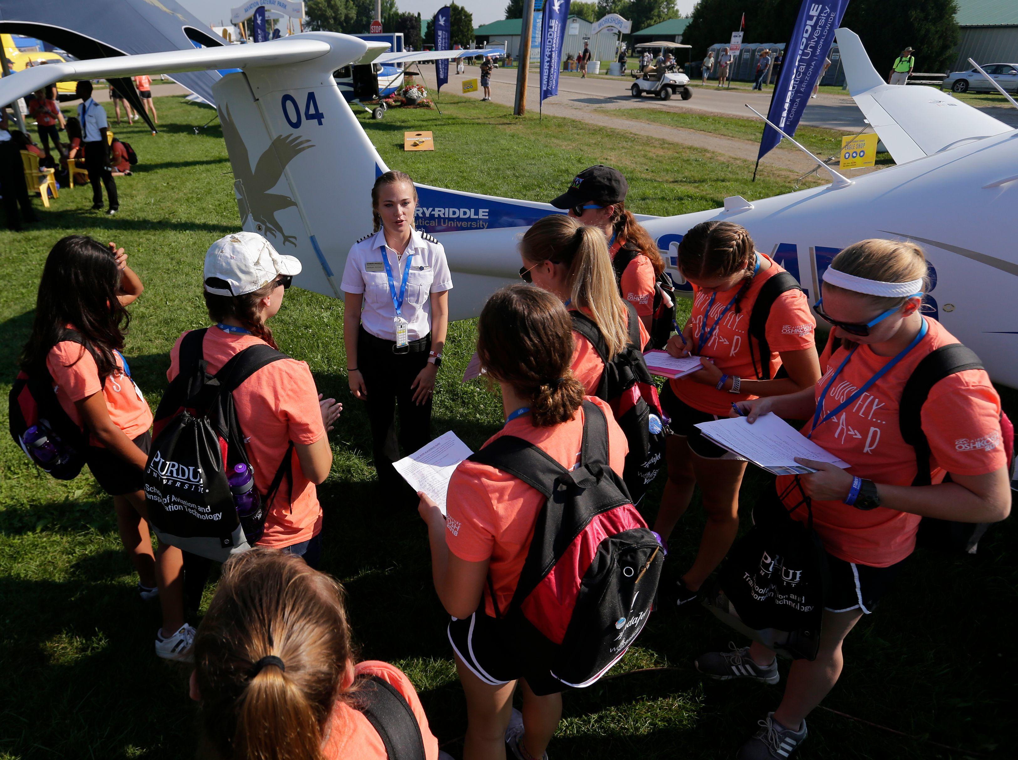 Pilot Hannah Rooney of Embry-Riddle Aeronautical University in Daytona Beach, Florida, talks with prospective candidates,Tuesday, July 24, 2018, at EAA AirVenture 2018 in Oshkosh.