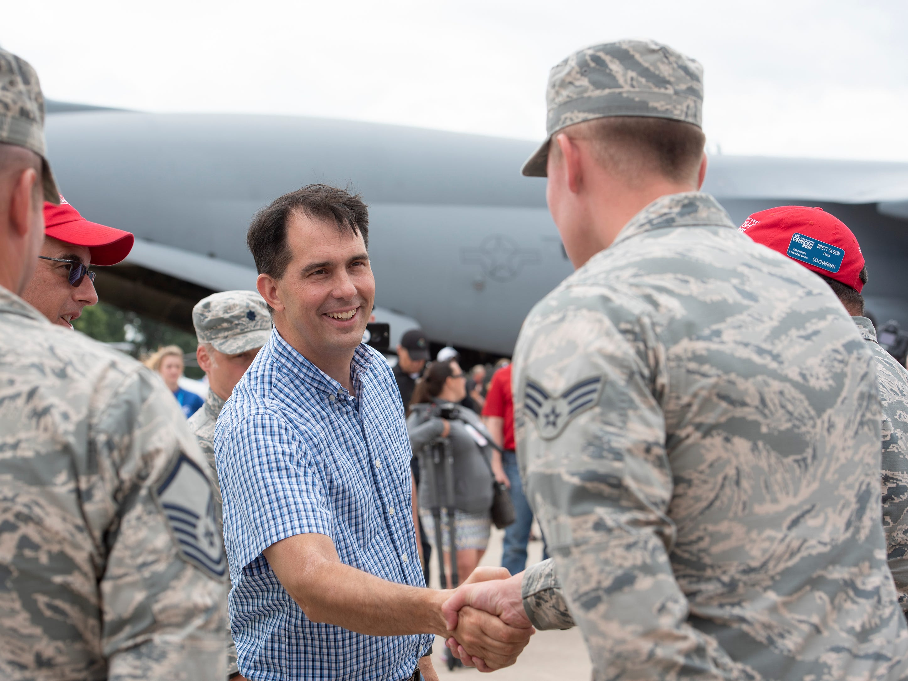Gov. Scott Walker greets members of the Wisconsin Air National Guard in Boeing Plaza at AirVenture in Oshkosh, Wis., on Thursday, July 26, 2018.
