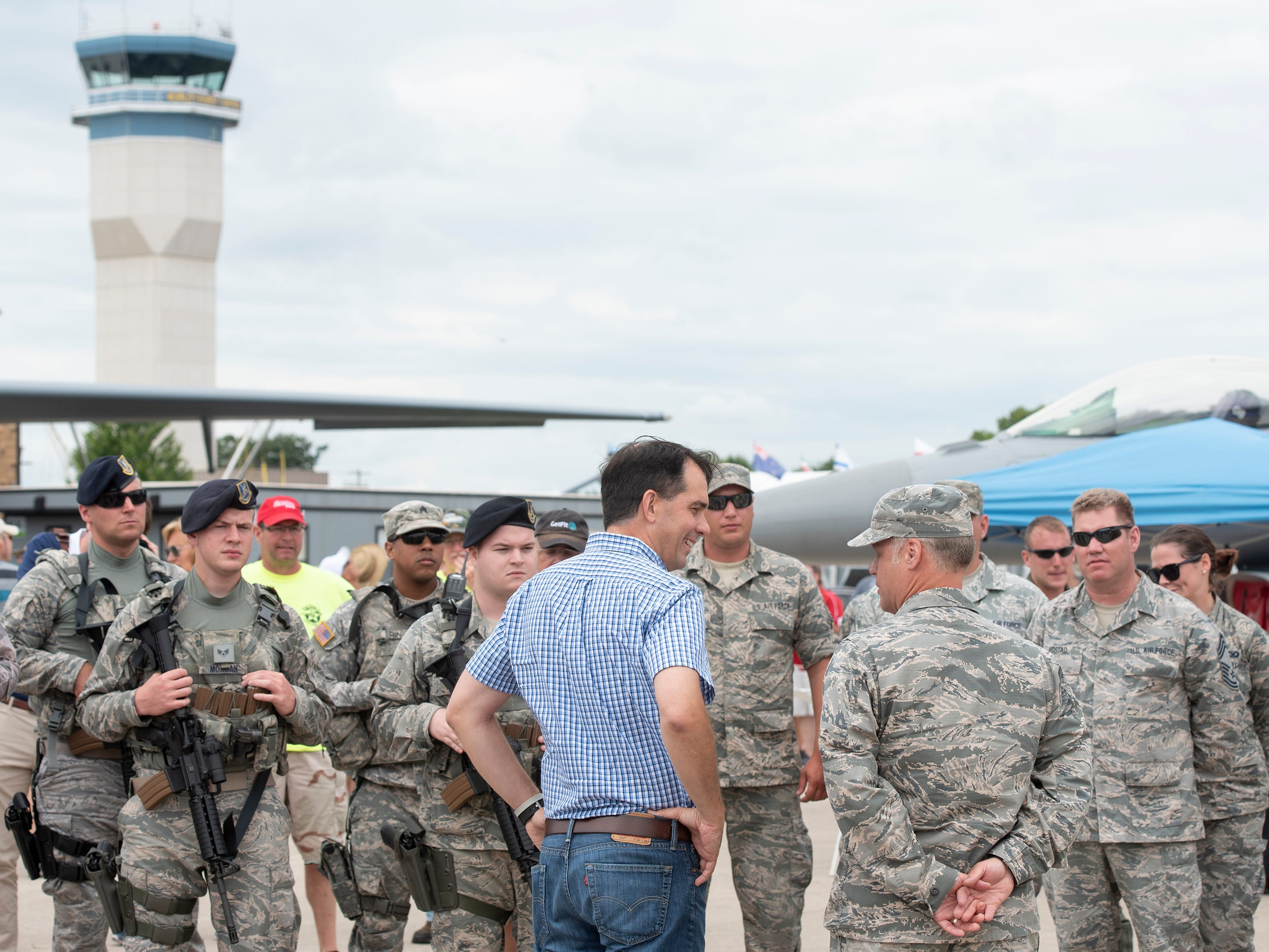 Gov. Scott Walker speaks with members of the Wisconsin Air National Guard in Boeing Plaza at AirVenture in Oshkosh, Wis., on Thursday, July 26, 2018. Walker then toured a 128th Air Refueling Wing parked nearby.