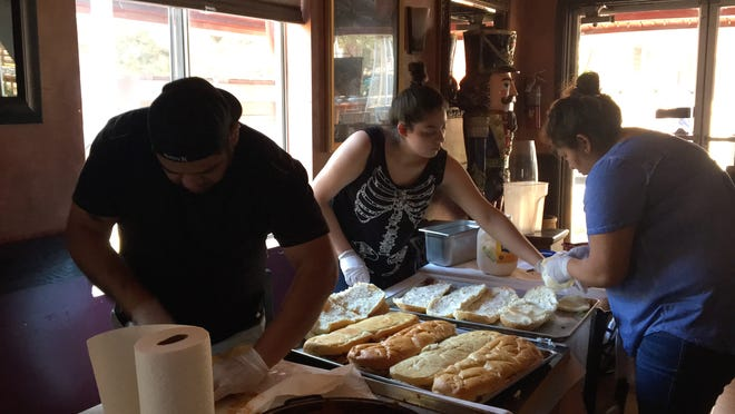 Fratello's Ristorante & Pizzeria prepares food for firefighters battling the Cranston Fire in Idyllwild Thursday, July 27, 2018.