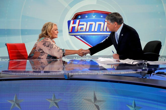 """Roseanne Barr greets Fox News talk-show host Sean Hannity on July 26, 2018, in New York. The interview was Barr's first on the show since ABC fired her from its successful reboot of """"Roseanne"""" in May following the star's racist tweet about former Obama adviser Valerie Jarrett."""