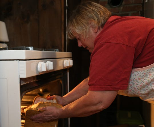 Cathy Stark removes an apple pie from the oven at her home in Salt Point on July 26, 2018. Stark has been competing in the Dutchess County Fair for 25 consecutive years, plans to enter several of her baked this year.