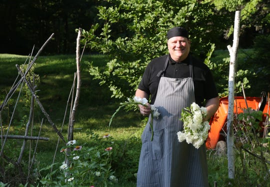 Troy Franke in his monochromatic garden at his home in Hyde Park on July 26, 2018. Franke enters multiple competitions at the Dutchess County Fair, including baking, antiques, flowers, & photography.