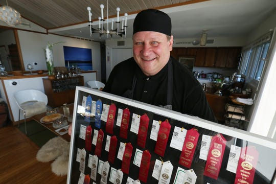 Troy Franke holds  display of ribbons he won at the 2017 Dutchess County Fair at his home in Hyde Park on July 26, 2018.
