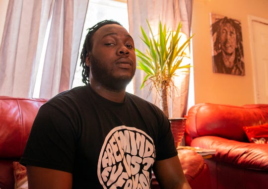 """Jerrell Grandison-Douglas sits for a portrait after recalling the night that his friend, Chad Merrill, was shot for allegedly defending Grandison-Douglas from racial slurs. """"Whether the story is told or not, you're still going through [racism],"""" Grandison-Douglas said. """"And you do whatever you can to protect yourself, whether it's looking over your shoulder at all times or making sure you can see everybody in the bar, or making sure there's no one behind you. It's just something that's ingrained into your being, and you just do it subconsciously. You don't even think about it anymore."""""""
