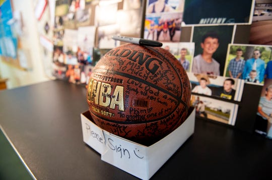 Funeral attendees were asked to sign a basketball for Chad Merrill, Friday, July 27, 2018. Almost 200 people gathered in Valley View Alliance Church, in Hellam Township, to remember and celebrate the life of Merrill, who was shot dead on July 21 outside the Red Rose Restaurant and Lounge. F