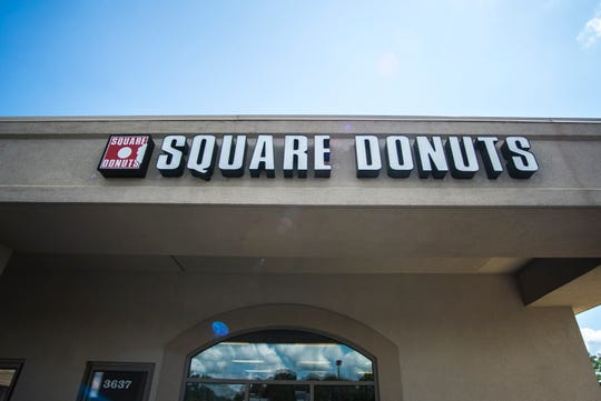The exterior of the east-side Square Donuts store is seen after hours on Friday, July 27, 2018.