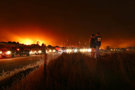 Residents of Redding, California, evacuate as the Carr fire makes its way into the city in July 2018. Hung T. Vu/Special to the Redding Record Searchlight