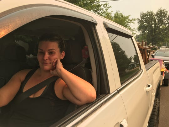 Amy Hernandez, 39, of Redding evacuates an urban Redding neighborhood ahead of the Carr Fire on July 27, 2018.