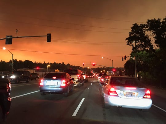 Traffic backs up on North Market Street in Redding Thursday evening as residents flee evacuated areas in front of the Carr Fire.
