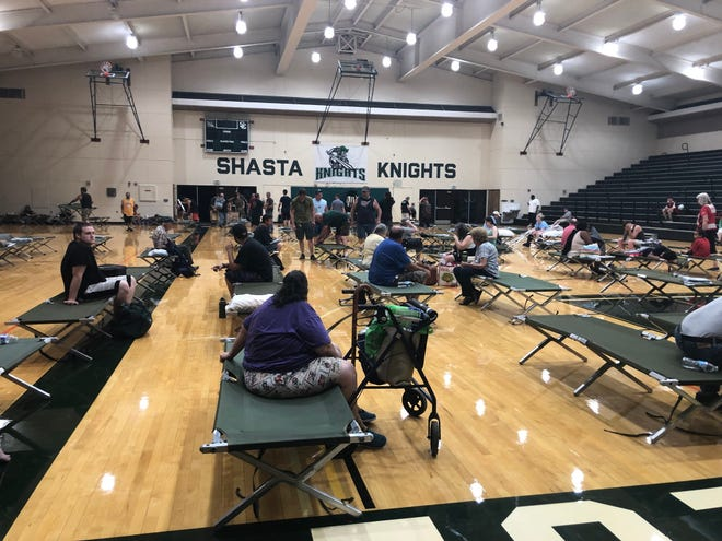 The scene at evacuation shelter  Shasta College. Parking lot packed.