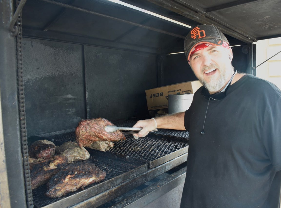 Jason Gloss barbecues tri-tip at the mercury heads to 110 degrees in Redding.