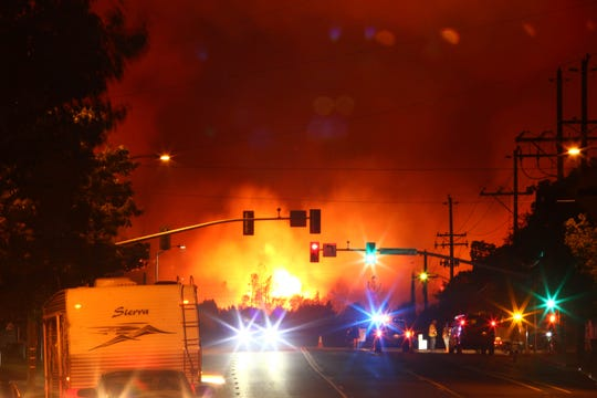 Carr Fire - Redding is under evacuation on Thursday night as the Carr fire make it way into the city. A long line of traffic on Buenaventura Blvd along Benton Air Park. Power outage in many subdivision, Streets closure into areas of burning. (photo by Hung T. Vu)