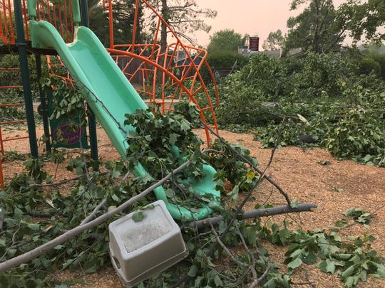 This playground next to the Lake Redding Estates home of Justin Montes is filled with tree branches that were blown off during the Carr Fire on Thursday night.