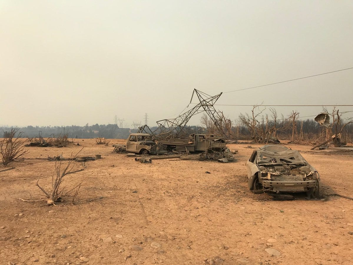 A high voltage transmission tower melted due to the intense fire overnight.