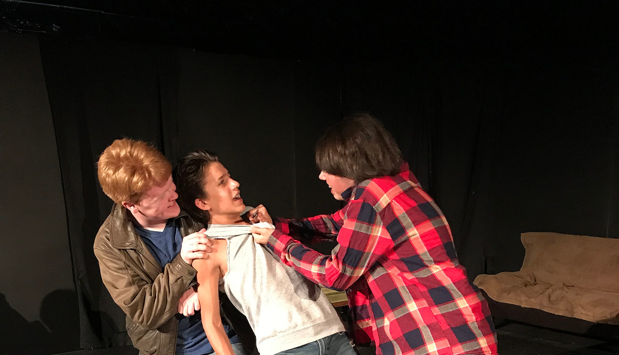 """Rival gang members Randy (Kyle Thompson), left, and Bob (Robert Burke), right, challenge Ponyboy Curtis (Jessie Lane Jr.) in a scene from """"The Outsiders."""" The coming-of-age drama opens Aug. 3."""
