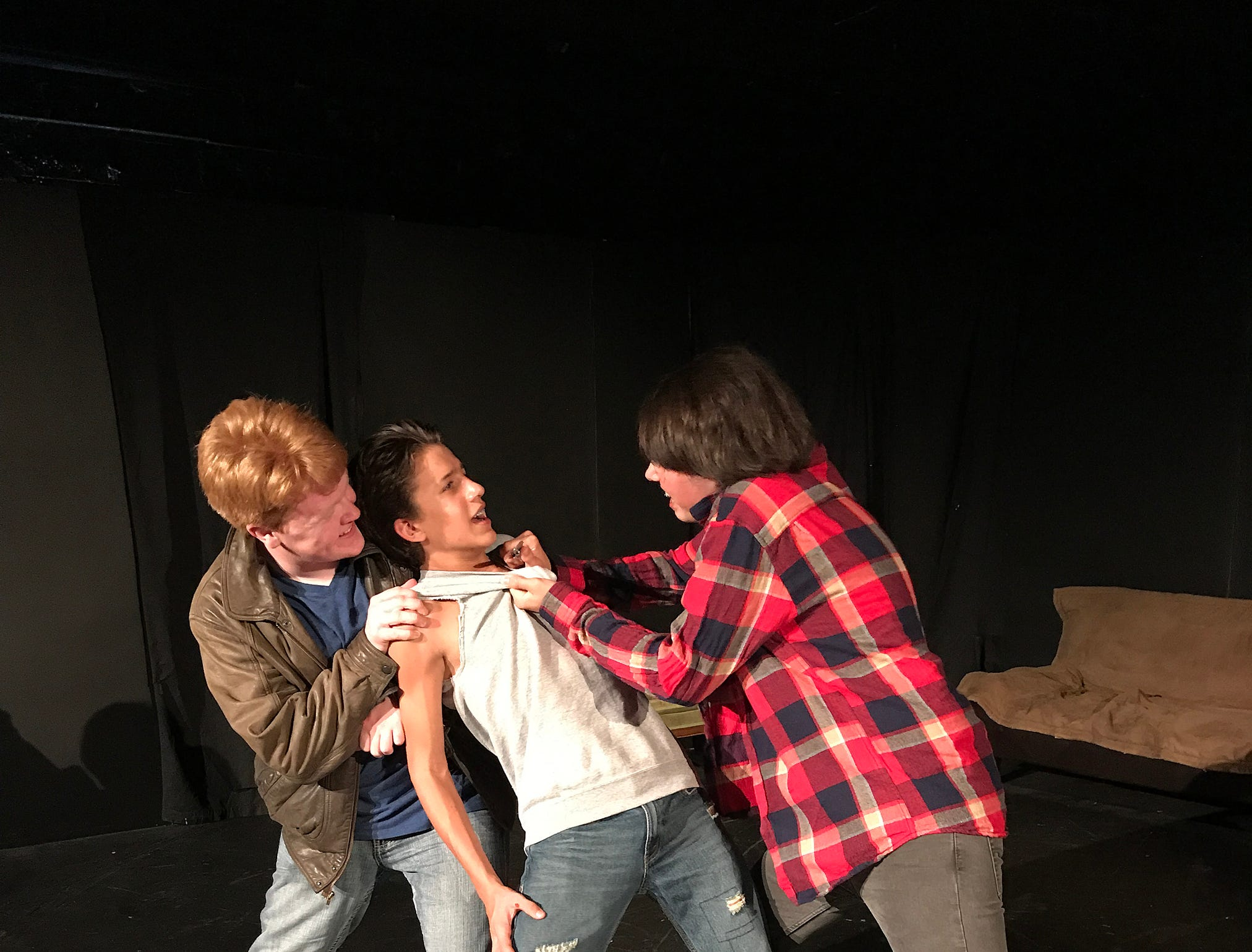 "Rival gang members Randy (Kyle Thompson), left, and Bob (Robert Burke), right, challenge Ponyboy Curtis (Jessie Lane Jr.) in a scene from ""The Outsiders."" The coming-of-age drama opens Aug. 3."
