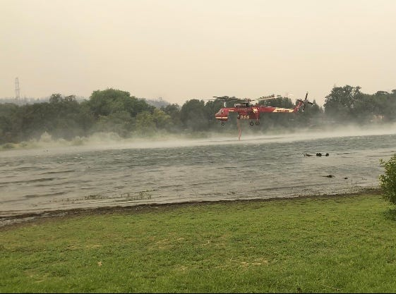 Helicopters suck water from Lake Mary Friday morning.