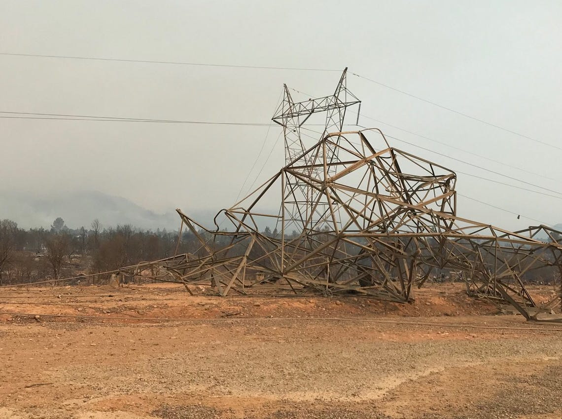 A high voltage transmission tower melted and was blown over by the Carr Fire.