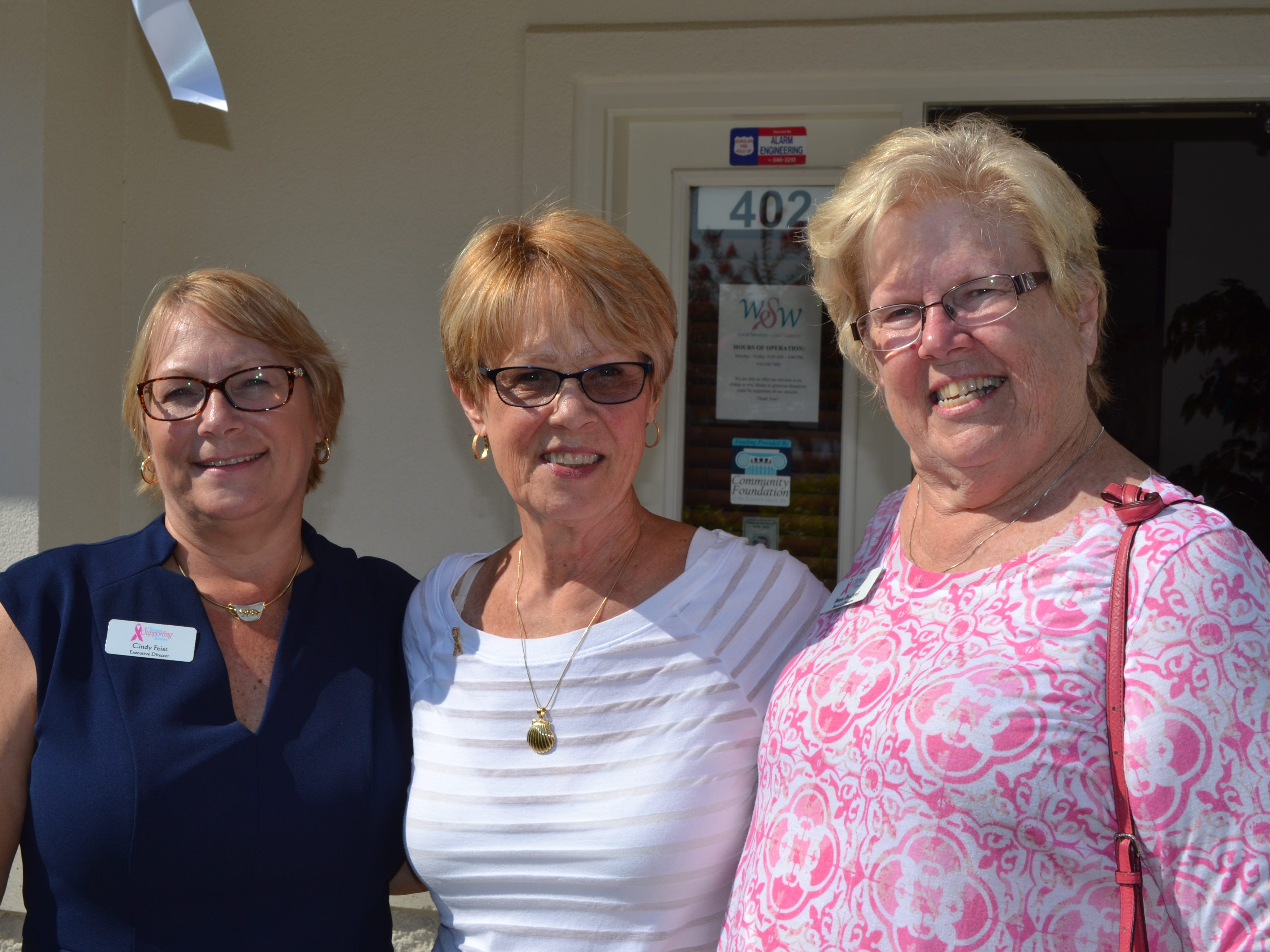 From left, Women Supporting Women executive director Cindy Feist, founder Sue Revelle and board member Penny Bradford attend the 25th anniversary party for the breast cancer support organization in Salisbury on Thursday, July 26.