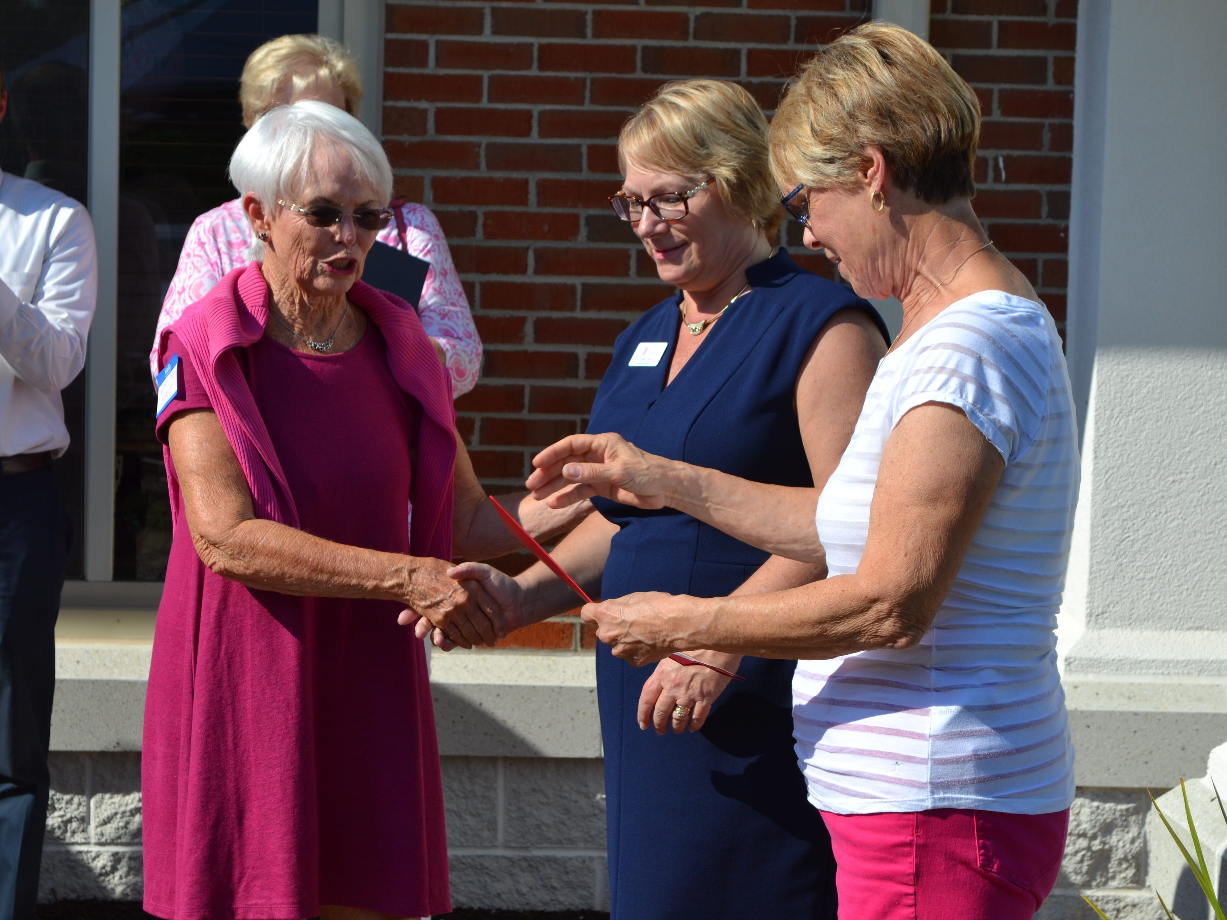 Sen. Addie Eckhardt, left, presents a Maryland Senate proclamation during  the 25th anniversary party for Women Supporting Women, a  breast cancer support organization in Salisbury, on Thursday, July 26.