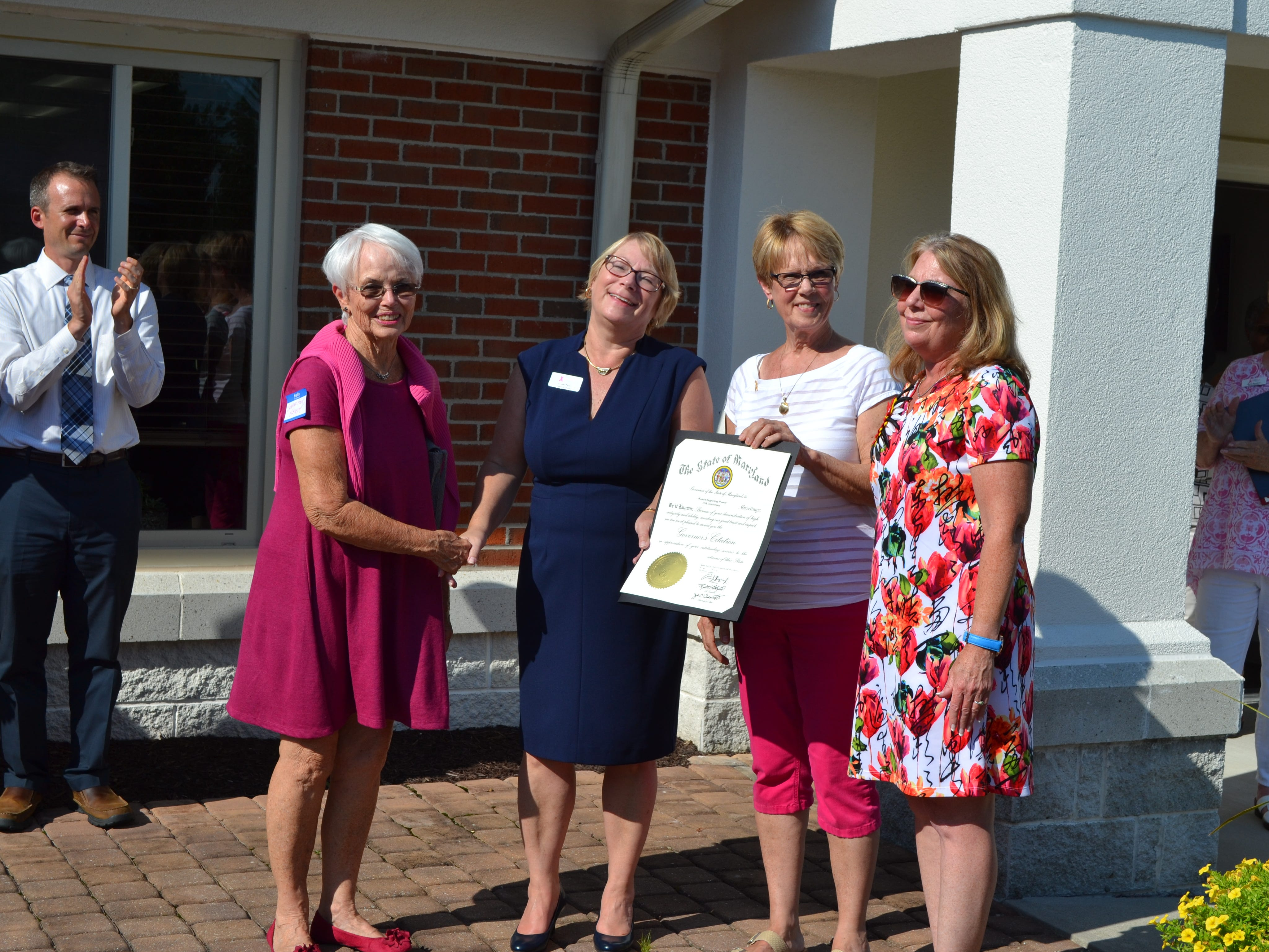 From left, Sen. Addie Eckhardt, Women Supporting Women Executive Director Cindy Feist, WSW founder Sue Revelle and Delegate Mary Beth Carozza pose with a proclamation from Gov. Larry Hogan during  the 25th anniversary party for Women Supporting Women, a  breast cancer support organization in Salisbury, on Thursday, July 26.