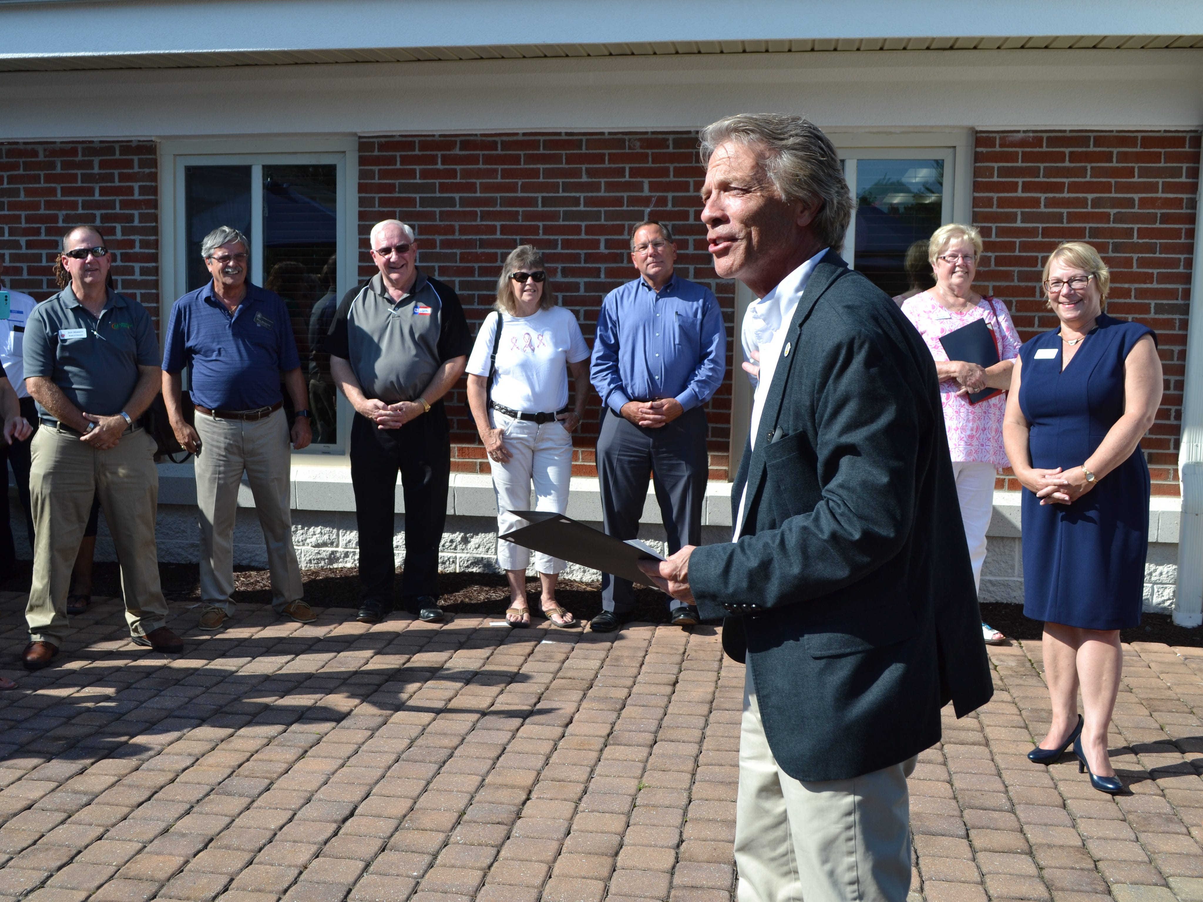 Wicomico County Council President John Cannon speaks during  the 25th anniversary party for Women Supporting Women, a  breast cancer support organization in Salisbury, on Thursday, July 26.