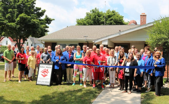 Ribbon cutting for Samaritan's Hand Sober House in Sheboygan in July 2018.